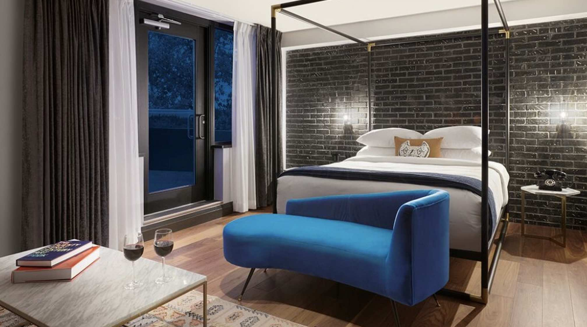 The Anndore House is one of the top luxury Yorkville hotels bedroom at night