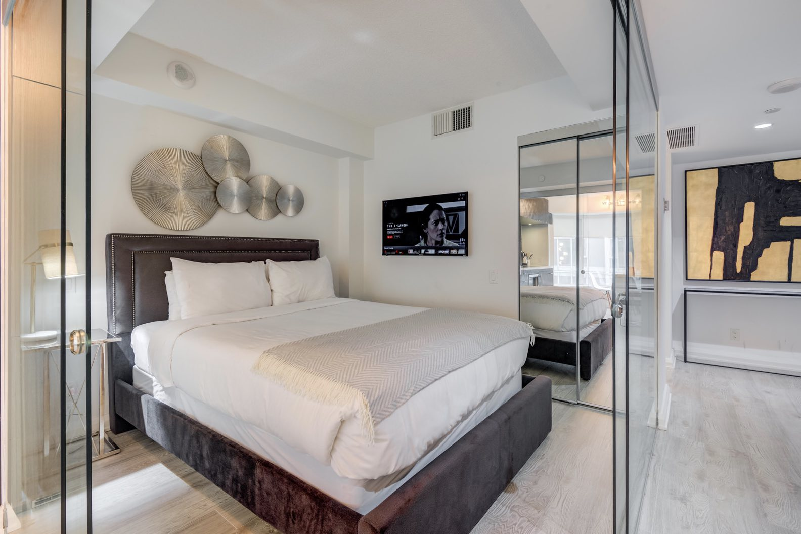 The Avalaon Yorkville bedroom with glass walls